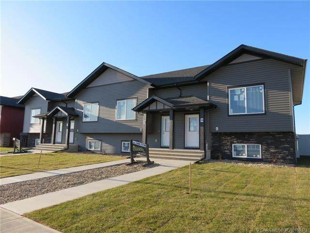 62,66,70,74 Mackenzie Ranch Way, Lacombe, AB T4L 0R1 (#CA0180373) :: Canmore & Banff