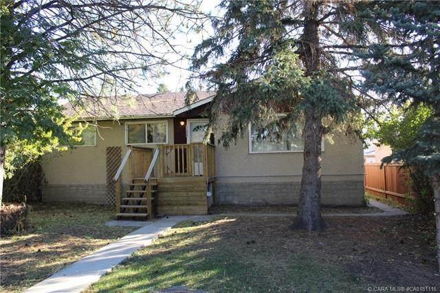 11005 155 Street NW, Edmonton, AB T5P 2N4 (#CA0181116) :: Redline Real Estate Group Inc