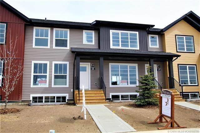 15 Iron Gate Boulevard, Sylvan Lake, AB A1A 2B2 (#CA0184795) :: Canmore & Banff