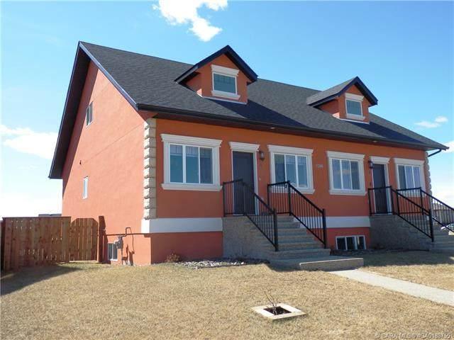 7305A 44B Avenue, Camrose, AB T4V 5E1 (#CA0188755) :: Canmore & Banff