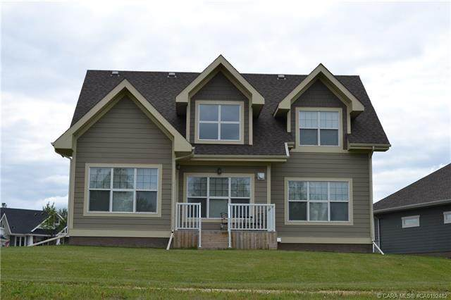 555 Summer Crescent, Rural Ponoka County, AB T4L 2N3 (#CA0192482) :: Canmore & Banff