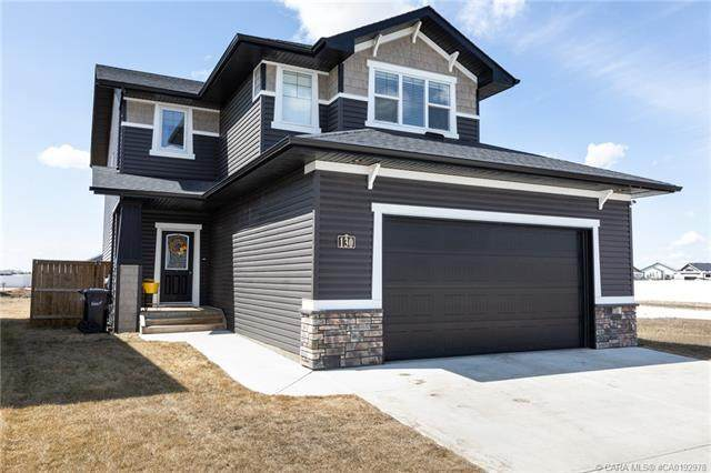 130 Mann Drive, Penhold, AB T0M 1R0 (#CA0192978) :: Canmore & Banff