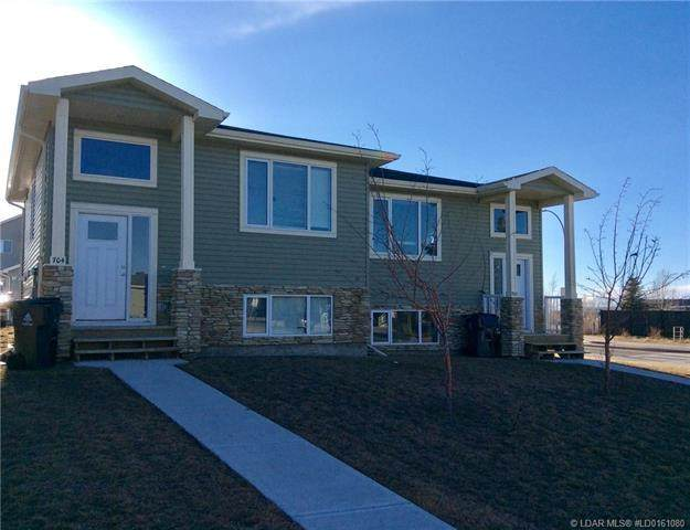 702/704 Mt Sundance Lane W, Lethbridge, AB T1J 0T3 (#LD0161080) :: Redline Real Estate Group Inc