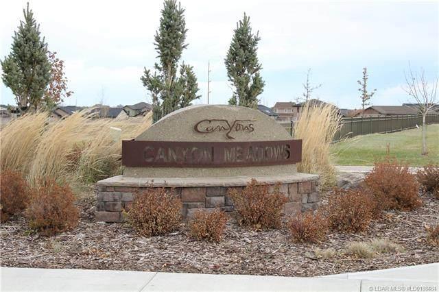 310 Canyon Meadows Road W, Lethbridge, AB T1K 8E7 (#LD0188484) :: Canmore & Banff