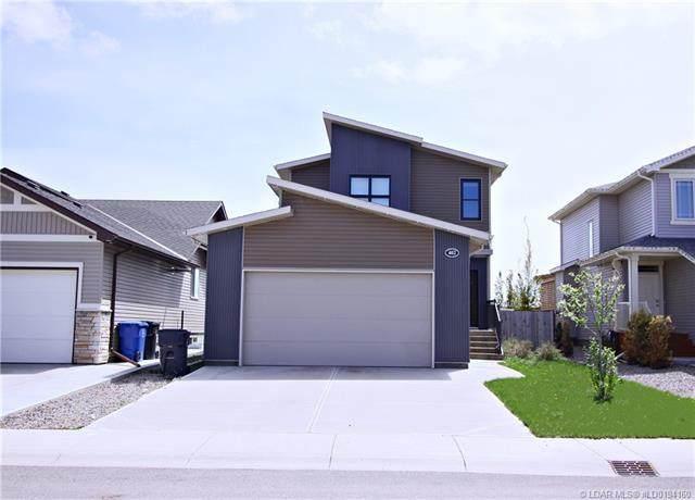 402 Mt Sundance Landing W, Lethbridge, AB T1J 5H9 (#LD0194160) :: Redline Real Estate Group Inc