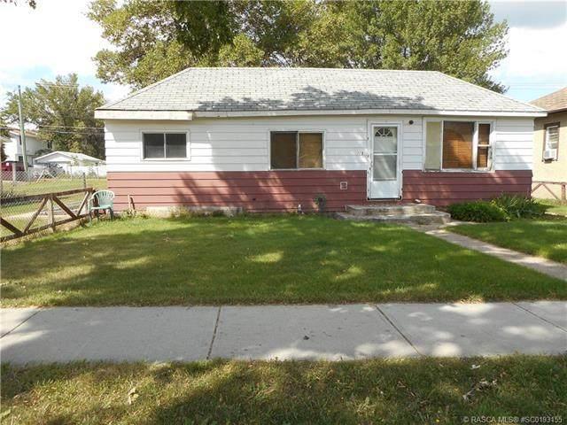 215 3 Street E, Brooks, AB T1R 0H2 (#SC0193155) :: Canmore & Banff