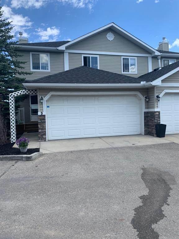 Unit 9,  117 Bow Ridge Drive #9, Cochrane, AB T4C 2G9 (#A1108347) :: Calgary Homefinders