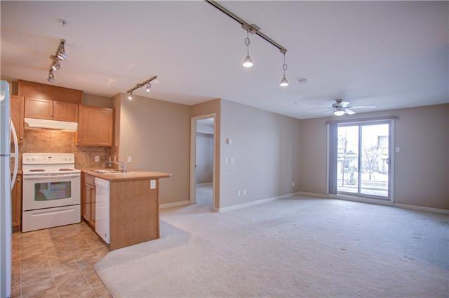 92 Crystal Shores Road #1110, Okotoks, AB T1S 2M8 (#C4164606) :: Redline Real Estate Group Inc