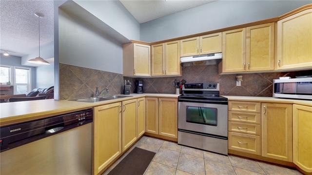 248 Sunterra Ridge Place #105, Cochrane, AB T4C 2J6 (#C4174445) :: Redline Real Estate Group Inc