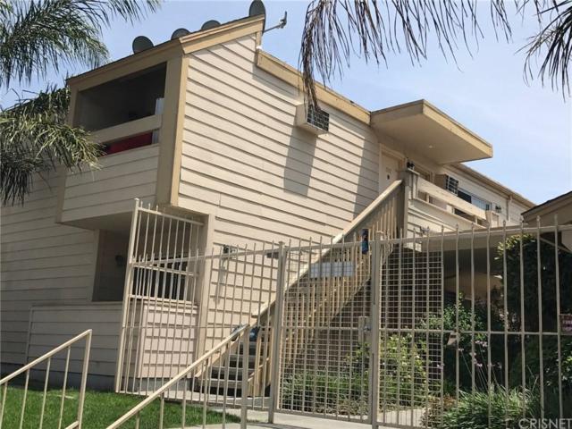 20930 Parthenia Street #201, Canoga Park, CA 91304 (#SR17238300) :: Paris and Connor MacIvor