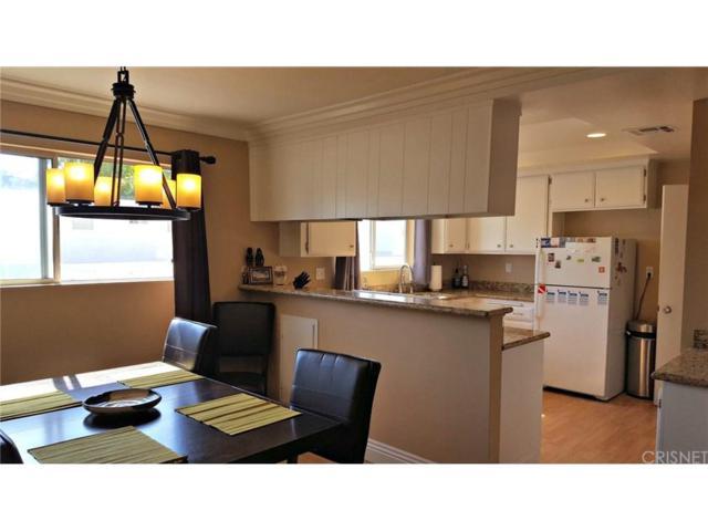 18550 Hatteras Street #117, Tarzana, CA 91356 (#SR18041393) :: Golden Palm Properties