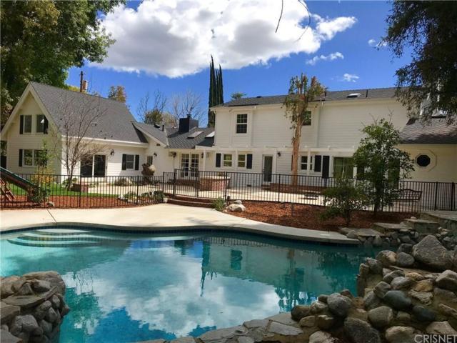 23015 Oxnard Street, Woodland Hills, CA 91367 (#SR18063853) :: Lydia Gable Realty Group