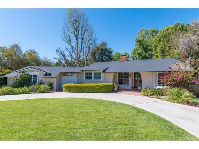 23249 Gonzales Drive, Woodland Hills, CA 91367 (#SR18092406) :: Golden Palm Properties