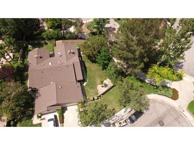 23707 Via Tomas, Valencia, CA 91355 (#SR18124850) :: Heber's Homes