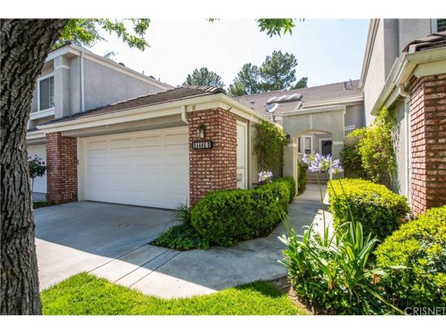 24446 Hampton Drive B, Valencia, CA 91355 (#SR18134879) :: Paris and Connor MacIvor