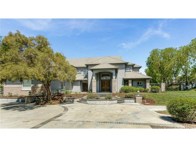 26921 Whitehorse Place, Canyon Country, CA 91387 (#SR18154789) :: Heber's Homes