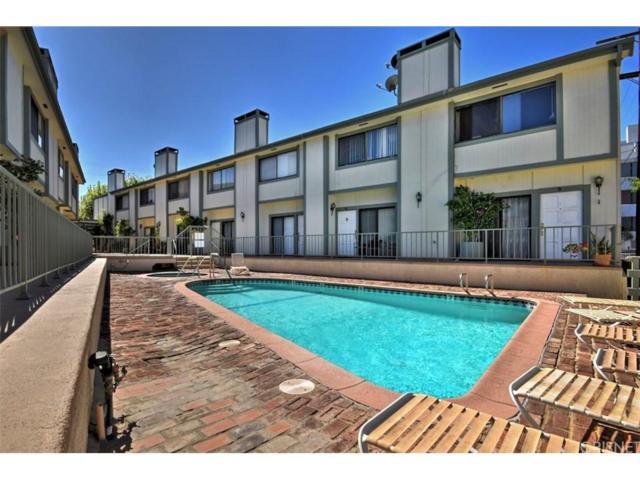 22865 Del Valle Street #9, Woodland Hills, CA 91364 (#SR18256528) :: Paris and Connor MacIvor