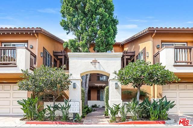 2960 Champion Way #302, Tustin, CA 92782 (#21-776914) :: The Bobnes Group Real Estate