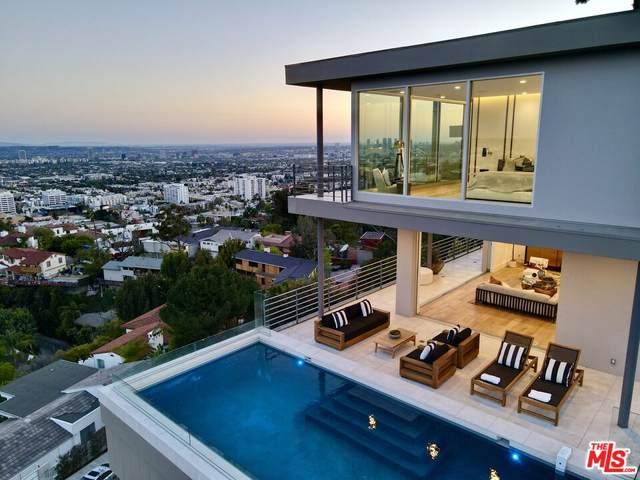 7007 Los Tilos Rd, Los Angeles, CA 90068 (#21-787714) :: The Grillo Group