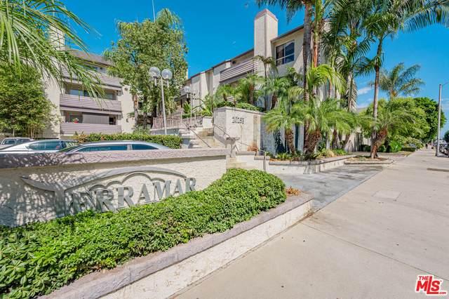 20253 Keswick St #209, Winnetka, CA 91306 (#21-787914) :: The Bobnes Group Real Estate