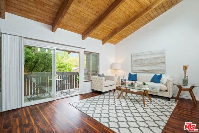 18350 Hatteras St #227, Tarzana, CA 91356 (#21-789380) :: Vida Ash Properties | Compass