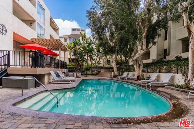 5325 Newcastle Ave #228, Encino, CA 91316 (#21-794616) :: Berkshire Hathaway HomeServices California Properties