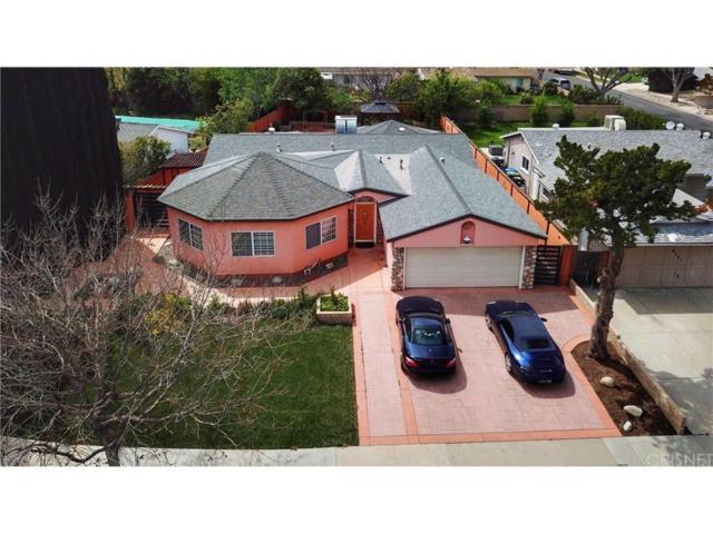 6233 Kenwater Avenue, Woodland Hills, CA 91367 (#SR19082113) :: Paris and Connor MacIvor