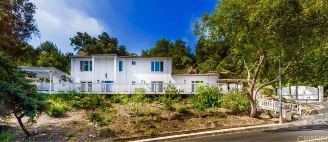16434 Royal Hills Drive, Encino, CA 91436 (#SR19084930) :: Paris and Connor MacIvor