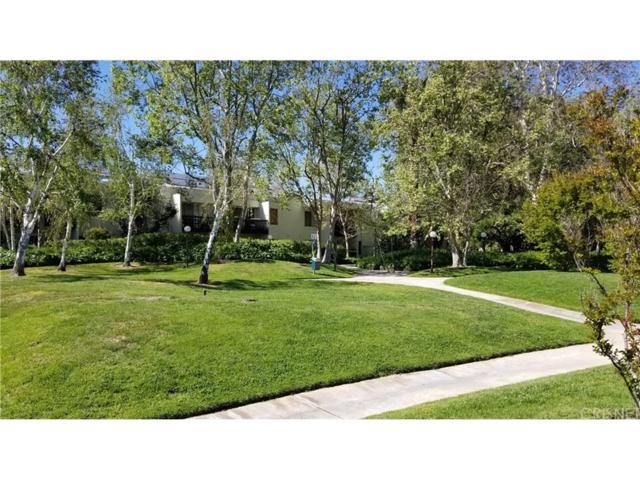 23515 Lyons Avenue #205, Valencia, CA 91355 (#SR19089639) :: Paris and Connor MacIvor
