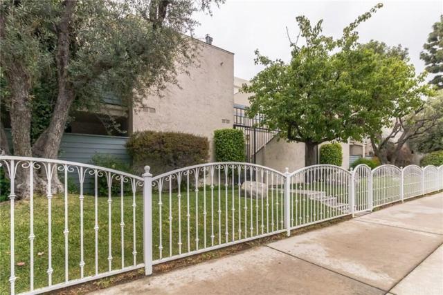 18411 Hatteras Street #202, Tarzana, CA 91356 (#SR19110852) :: Paris and Connor MacIvor