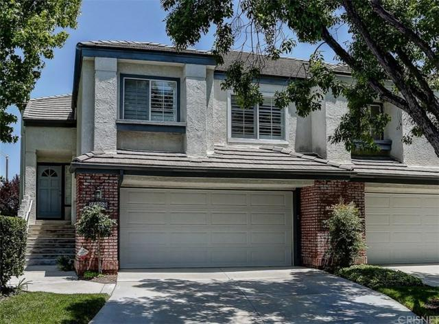 24402 Hampton Drive B, Valencia, CA 91355 (#SR19119696) :: Paris and Connor MacIvor