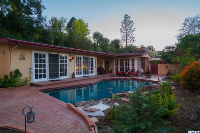 15980 Valley Wood Road, Sherman Oaks, CA 91403 (#319002835) :: The Agency