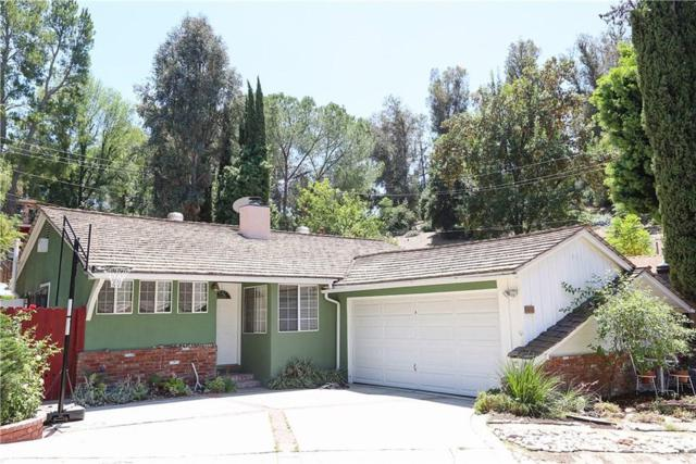 4889 Escobedo Drive, Woodland Hills, CA 91364 (#SR19172999) :: The Fineman Suarez Team