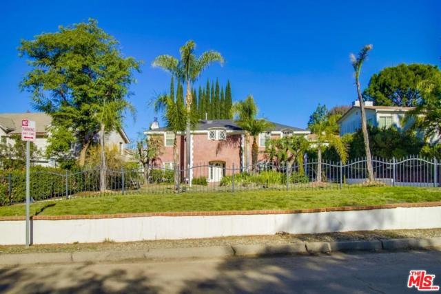 21237 Mulholland Drive, Woodland Hills, CA 91364 (#18415426) :: Golden Palm Properties