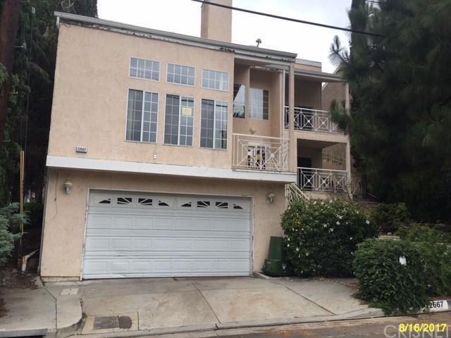 22667 Margarita Drive, Woodland Hills, CA 91364 (#SR17211519) :: Paris and Connor MacIvor
