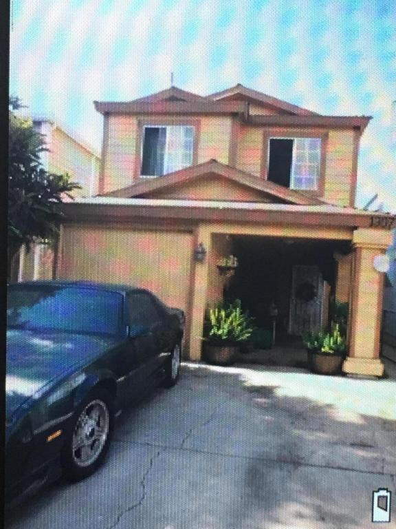 1307 E 100TH Street, Los Angeles (City), CA 90002 (#818003010) :: Paris and Connor MacIvor