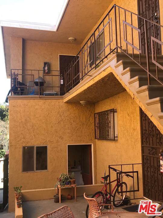 1650 Lucretia Ave, Los Angeles, CA 90026 (MLS #20-562722) :: The John Jay Group - Bennion Deville Homes