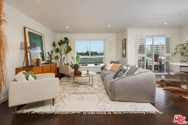 5764 San Vicente Blvd #304, Los Angeles, CA 90019 (#20-636134) :: Lydia Gable Realty Group