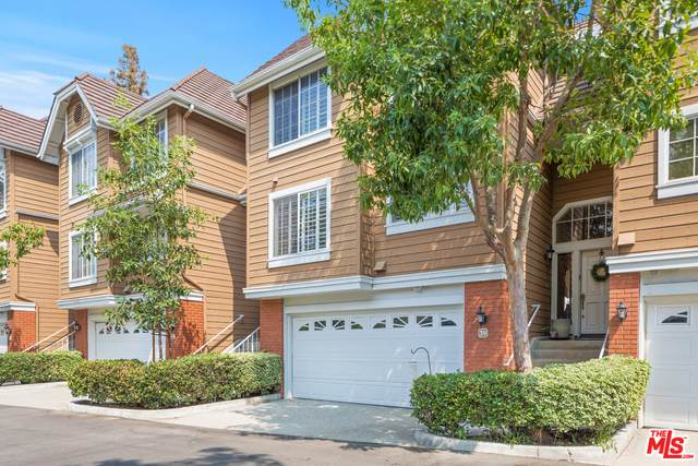 20950 Oxnard St #39, Woodland Hills, CA 91367 (#20-646106) :: The Pratt Group