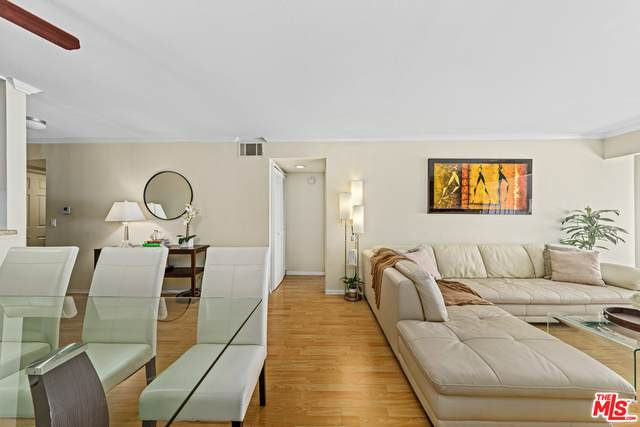 5500 Owensmouth Ave #122, Woodland Hills, CA 91367 (#20-648464) :: The Parsons Team