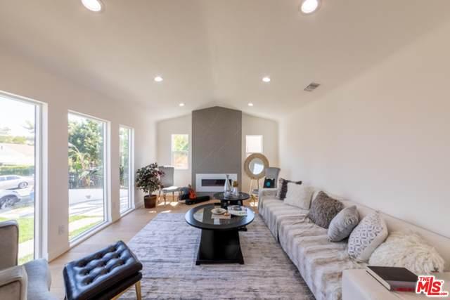 1163 S Muirfield Rd, Los Angeles, CA 90019 (#20-666602) :: The Ellingson Group