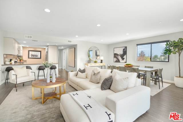 5826 W Olympic Blvd #201, Los Angeles, CA 90036 (#21-698490) :: Berkshire Hathaway HomeServices California Properties