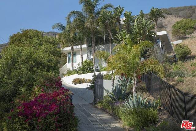 3656 Las Flores Canyon Rd, Malibu, CA 90265 (MLS #21-729598) :: The Jelmberg Team