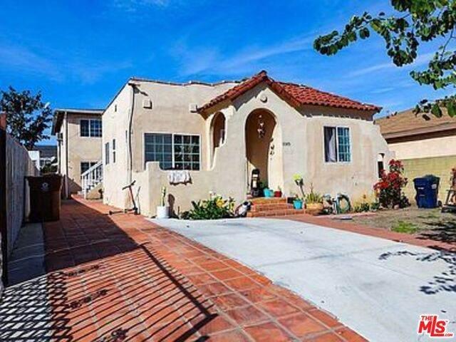 11149 W Berendo Ave, Los Angeles, CA 90044 (MLS #21-738960) :: The Sandi Phillips Team