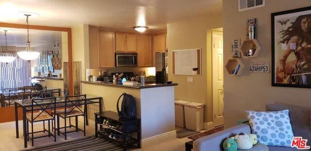 2380 Del Mar Way #206, Corona, CA 92882 (MLS #21-745588) :: The John Jay Group - Bennion Deville Homes