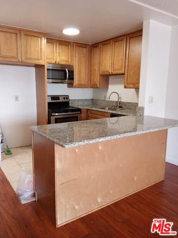 425 S Kenmore Ave #303, Los Angeles, CA 90020 (MLS #21-764704) :: The John Jay Group - Bennion Deville Homes