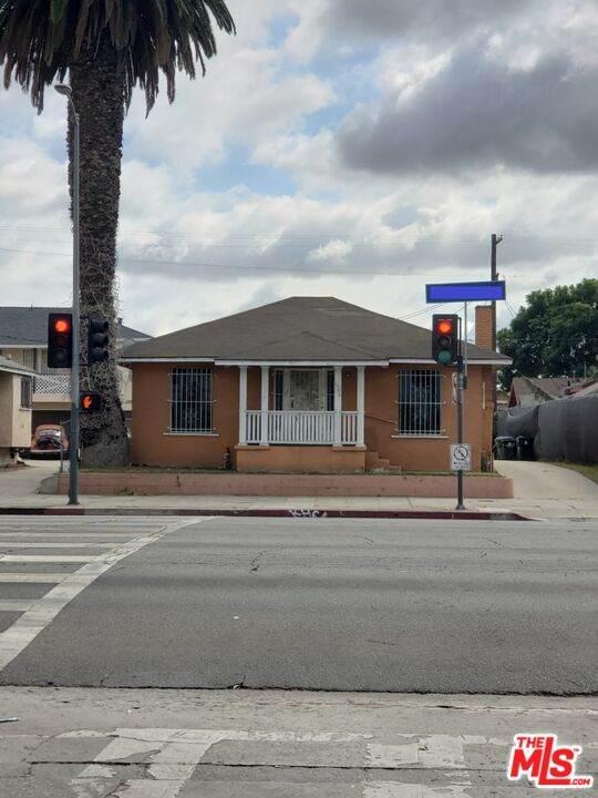 1156 W Florence Ave, Los Angeles, CA 90044 (MLS #21-793838) :: The Sandi Phillips Team