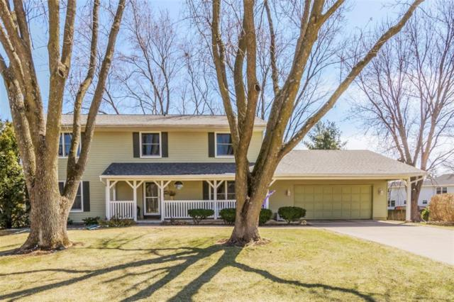 6911 Wilton Court NE, Cedar Rapids, IA 52402 (MLS #1802569) :: WHY USA Eastern Iowa Realty