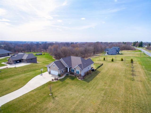 1334 Spring Ridge Court NE, Swisher, IA 52338 (MLS #1802803) :: The Graf Home Selling Team
