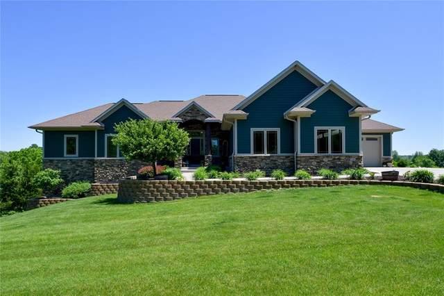 1384 Lakewoods NE, Swisher, IA 52338 (MLS #2004565) :: The Graf Home Selling Team